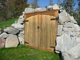 Root cellar with boulder rock walls