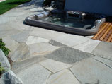 Flagstone patio inlay with inset hot tub
