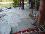 Flagstone placement and staging during construction