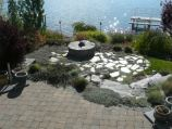 Stone firepit, flagstone, and paver patio