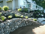 Curved rock retaining wall