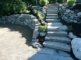 Stone stairway between rock retaining walls