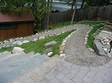 Paver patio with stone steps and gravel walkway