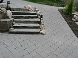 Lighted stone steps and paver pathway