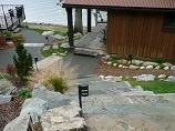 Stone stairway and lighted pathway down to deck and dock