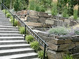 Multiple tier fitted rock retaining walls