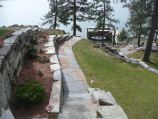 Cut stone pathway, retaining wall and pathway lighting