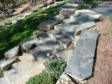 Stone stairway and boulder retaining wall