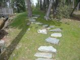 Rock stairway and path placed in grass