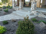 Sandstone stairs carefully cut and installed into paver walkway