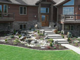 Pennsylvania sandstone stairway with water feature and boulder accents