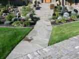 Pennsylvania sandstone steps and walkway connecting to European paver driveway
