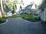 Paver driveway with parking space in front of the garage