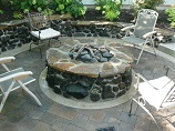 Sunken gas stone firepit with matching stone retaining wall