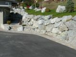 Driveway lined with natural rough granite boulders and granite steps