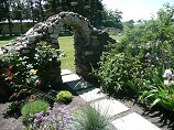 Self-supported rock arch garden entry