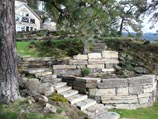 Multi-tiered retaining wall using rectangular 'Stutzke Stone' from Clark Fork