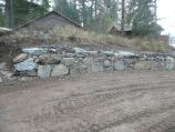 Mixed stone, native and imported, retaining wall