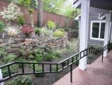 Side yard retaining wall with natural wall cover