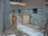 Square stepping stones with custom cedar fence and gate