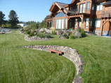 Highly contoured lawn with drystacked retaining walls