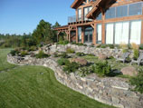 Drystacked rock retaining walls  on sun drenched exposure