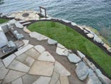 Flagstone patio with sod on lower level