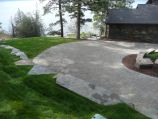 Raised lawn with paver driveway
