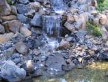 Tri-tier natural boulder waterfall into a collection pond